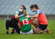12 June 2021; Mayo team physio Rachel Tierney, left, and Dublin team doctor Noëlle Healy treat Maria Reilly of Mayo for an injury during the Lidl Ladies National Football League Division 1 semi-final match between Dublin and Mayo at LIT Gaelic Grounds in Limerick. Photo by Piaras Ó Mídheach/Sportsfile