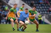 12 June 2021; Con O'Callaghan of Dublin in action against Hugh McFadden, left, and Brendan McCole of Donegal during the Allianz Football League Division 1 semi-final match between Donegal and Dublin at Kingspan Breffni Park in Cavan. Photo by Stephen McCarthy/Sportsfile