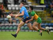 12 June 2021; Peadar Ó Cofaigh Byrne of Dublin in action against Ethan O'Donnell of Donegal during the Allianz Football League Division 1 semi-final match between Donegal and Dublin at Kingspan Breffni Park in Cavan. Photo by Stephen McCarthy/Sportsfile