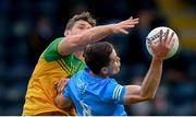 12 June 2021; Brian Fenton of Dublin in action against Hugh McFadden of Donegal during the Allianz Football League Division 1 semi-final match between Donegal and Dublin at Kingspan Breffni Park in Cavan. Photo by Stephen McCarthy/Sportsfile