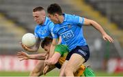 12 June 2021; Conor O'Donnell of Donegal in action against Paddy Small, left, and David Byrne of Dublin during the Allianz Football League Division 1 semi-final match between Donegal and Dublin at Kingspan Breffni Park in Cavan. Photo by Stephen McCarthy/Sportsfile