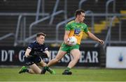 12 June 2021; Eoghan McGettigan of Donegal shoots to score his side's goal, despite the attention of Dublin goalkeeper Evan Comerford during the Allianz Football League Division 1 semi-final match between Donegal and Dublin at Kingspan Breffni Park in Cavan. Photo by Stephen McCarthy/Sportsfile