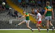 12 June 2021; Jason Foley of Kerry kicks a point despite the efforts of Peter Harte of Tyrone during the Allianz Football League Division 1 semi-final match between Kerry and Tyrone at Fitzgerald Stadium in Killarney, Kerry. Photo by Brendan Moran/Sportsfile