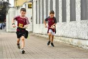 13 June 2021; Young Westmeath supporters Tom  Nolan, left, age 8, and Daniel Conaty, age 7, from Collinstown, Westmeath, solo their way to the ground before the Allianz Hurling League Division 1 Group A Round 5 match between Westmeath and Limerick at TEG Cusack Park in Mullingar, Westmeath. Photo by Seb Daly/Sportsfile