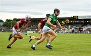 13 June 2021; Conor Boylan of Limerick in action against Tommy Gallagher, left, and Aonghus Clarke of Westmeath during the Allianz Hurling League Division 1 Group A Round 5 match between Westmeath and Limerick at TEG Cusack Park in Mullingar, Westmeath. Photo by Seb Daly/Sportsfile