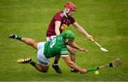 13 June 2021; Robbie Hanley of Limerick in action against Darragh Egerton of Westmeath during the Allianz Hurling League Division 1 Group A Round 5 match between Westmeath and Limerick at TEG Cusack Park in Mullingar, Westmeath. Photo by Seb Daly/Sportsfile