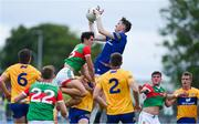 13 June 2021; Clare goalkeeper Stephen Ryan collects a high ball ahead of team-mate Conor Jordan and Tommy Conroy of Mayo during the Allianz Football League Division 2 semi-final match between Clare and Mayo at Cusack Park in Ennis, Clare. Photo by Brendan Moran/Sportsfile