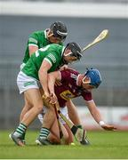 13 June 2021; Tommy Doyle of Westmeath in action against Barry Murphy and Gearoid Hegarty of Limerick during the Allianz Hurling League Division 1 Group A Round 5 match between Westmeath and Limerick at TEG Cusack Park in Mullingar, Westmeath. Photo by Seb Daly/Sportsfile