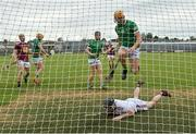 13 June 2021; Darren O'Connell of Limerick skips over Westmeath goalkeeper Noel Conaty after scoring his side's second goal during the Allianz Hurling League Division 1 Group A Round 5 match between Westmeath and Limerick at TEG Cusack Park in Mullingar, Westmeath. Photo by Seb Daly/Sportsfile