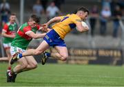 13 June 2021; Conor Jordan of Clare is tackled by Eoghan O'Donoghue of Mayo during the Allianz Football League Division 2 semi-final match between Clare and Mayo at Cusack Park in Ennis, Clare. Photo by Brendan Moran/Sportsfile