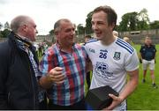 13 June 2021; Jack McCarron of Monaghan is congratulated by suspended Monaghan manager Seamus McEnaney, who was at the game as a spectator, after the Allianz Football League Division 1 Relegation play-off match between Monaghan and Galway at St. Tiernach's Park in Clones, Monaghan. Photo by Philip Fitzpatrick/Sportsfile