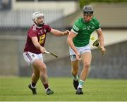 13 June 2021; Conor Boylan of Limerick in action against Derek McNicholas of Westmeath during the Allianz Hurling League Division 1 Group A Round 5 match between Westmeath and Limerick at TEG Cusack Park in Mullingar, Westmeath. Photo by Seb Daly/Sportsfile