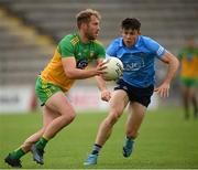 12 June 2021; Stephen McMenamin of Donegal in action against David Byrne of Dublin during the Allianz Football League Division 1 semi-final match between Donegal and Dublin at Kingspan Breffni Park in Cavan. Photo by Stephen McCarthy/Sportsfile