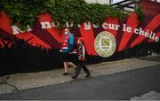 18 June 2021; St Patrick's Athletic supporters Stephen Nolan and Jack O'Brien-Flemming, aged nine, arrive before the SSE Airtricity League Premier Division match between St Patrick's Athletic and Sligo Rovers at Richmond Park in Dublin. Photo by Harry Murphy/Sportsfile