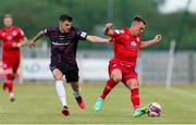18 June 2021; Dayle Rooney of Shelbourne in action against Karl Fitzsimons of Wexford during the SSE Airtricity League First Division match between Wexford and Shelbourne at Ferrycarrig Park in Wexford. Photo by Michael P Ryan/Sportsfile