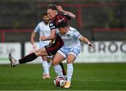 18 June 2021; Chris Lyons of Drogheda United in action against Ciaran Kelly of Bohemians during the SSE Airtricity League Premier Division match between Bohemians and Drogheda United at Dalymount Park in Dublin. Photo by Piaras Ó Mídheach/Sportsfile