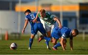 18 June 2021; Liam Scales of Shamrock Rovers in action against Adam O'Reilly, left, and Niall O'Keeffe of Waterford during the SSE Airtricity League Premier Division match between Waterford and Shamrock Rovers at the RSC in Waterford. Photo by Seb Daly/Sportsfile