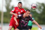 18 June 2021; James Carroll of Wexford in action against Ryan Brennan of Shelbourne during the SSE Airtricity League First Division match between Wexford and Shelbourne at Ferrycarrig Park in Wexford. Photo by Michael P Ryan/Sportsfile