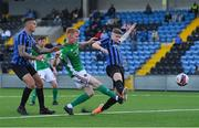 18 June 2021; Alec Byrne of Cork City shoots to score his side's first goal despite the attention of Scott Delaney, left, and Jamie Hollywood of Athlone Town during the SSE Airtricity League First Division match between Athlone Town and Cork City at Athlone Town Stadium in Athlone, Westmeath. Photo by Ramsey Cardy/Sportsfile