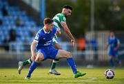 18 June 2021; John Martin of Waterford in action against Danny Mandroiu of Shamrock Rovers during the SSE Airtricity League Premier Division match between Waterford and Shamrock Rovers at the RSC in Waterford. Photo by Seb Daly/Sportsfile