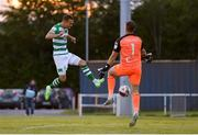 18 June 2021; Graham Burke of Shamrock Rovers scores his side's third goal, past Waterford goalkeeper Brian Murphy, during the SSE Airtricity League Premier Division match between Waterford and Shamrock Rovers at the RSC in Waterford. Photo by Seb Daly/Sportsfile