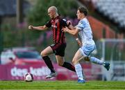 18 June 2021; Georgie Kelly of Bohemians in action against Daniel O'Reilly of Drogheda United during the SSE Airtricity League Premier Division match between Bohemians and Drogheda United at Dalymount Park in Dublin. Photo by Piaras Ó Mídheach/Sportsfile
