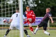 18 June 2021; Shane Farrell of Shelbourne has a shot on goal despite the attention of Lorcan Fitzgerald of Wexford during the SSE Airtricity League First Division match between Wexford and Shelbourne at Ferrycarrig Park in Wexford. Photo by Michael P Ryan/Sportsfile
