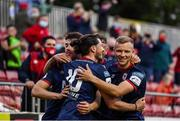 18 June 2021; Ronan Coughlan of St Patrick's Athletic, 10, celebrates after scoring his side's second goal with teammates Lee Desmond and Jamie Lennon during the SSE Airtricity League Premier Division match between St Patrick's Athletic and Sligo Rovers at Richmond Park in Dublin. Photo by Harry Murphy/Sportsfile