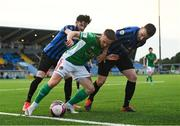 18 June 2021; Dylan McGlade of Cork City in action against Adam Wixted, left, and Aidan Friel of Athlone Town during the SSE Airtricity League First Division match between Athlone Town and Cork City at Athlone Town Stadium in Westmeath. Photo by Ramsey Cardy/Sportsfile