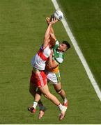 19 June 2021; Conor Glass of Derry in action against Eoin Carroll of Offaly during the Allianz Football League Division 3 Final match between Derry and Offaly at Croke Park in Dublin. Photo by Ray McManus/Sportsfile