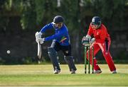 19 June 2021; Andy McBrine of North West Warriors plays a shot, watched by Munster Reds wicketkeeper PJ Moor during the Cricket Ireland InterProvincial Trophy 2021 match between between Munster Reds and North West Warriors at Pembroke Cricket Club in Dublin. Photo by Seb Daly/Sportsfile