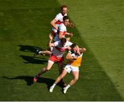 19 June 2021; Emmett Bradley of Derry, supported by Oisín McWilliams and Conor Glass in action against Anton Sullivan of Offaly during the Allianz Football League Division 3 Final match between between Derry and Offaly at Croke Park in Dublin. Photo by Ray McManus/Sportsfile