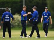 20 June 2021; Craig Young of North West Warriors, second left, celebrates the wicket of Andrew Balbirnie of Leinster Lightning with team-mate Graham Hume during the Cricket Ireland InterProvincial Trophy 2021 match between Leinster Lightning and North West Warriors at Pembroke Cricket Club in Dublin. Photo by Harry Murphy/Sportsfile