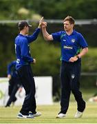 20 June 2021; Craig Young of North West Warriors, right, celebrates the wicked of Andrew Balbirnie of Leinster Lightning with team-mate Graham Kennedy during the Cricket Ireland InterProvincial Trophy 2021 match between Leinster Lightning and North West Warriors at Pembroke Cricket Club in Dublin. Photo by Harry Murphy/Sportsfile