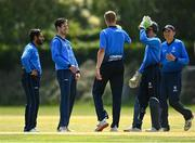 20 June 2021; Leinster Lightning players, including George Dockrell, second left, celebrate a wicket during the Cricket Ireland InterProvincial Trophy 2021 match between Leinster Lightning and North West Warriors at Pembroke Cricket Club in Dublin. Photo by Harry Murphy/Sportsfile