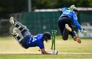 20 June 2021; Craig Young of North West Warriors dives in to win the match between despite the run out attempt of Lorcan Tucker of Leinster Lightning during the Cricket Ireland InterProvincial Trophy 2021 match between Leinster Lightning and North West Warriors at Pembroke Cricket Club in Dublin. Photo by Harry Murphy/Sportsfile