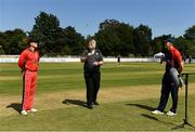 20 June 2021; Match referee Kevin Gallagher tosses the coin watched by Munster Reds captain PJ Moor and Northern Knights captain Harry Tector before the Cricket Ireland InterProvincial Trophy 2021 match between Northern Knights and Munster Reds at Pembroke Cricket Club in Dublin. Photo by Harry Murphy/Sportsfile