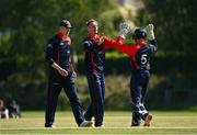 20 June 2021; Ben White of Northern Knights, centre, celebrates a wicket with Neil Rock during the Cricket Ireland InterProvincial Trophy 2021 match between Northern Knights and Munster Reds at Pembroke Cricket Club in Dublin. Photo by Harry Murphy/Sportsfile