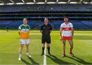 19 June 2021; Referee Seán Lonergan with team captains Niall Darby of Offaly and Christopher McKaigue of Derry before the Allianz Football League Division 3 Final match between Derry and Offaly at Croke Park in Dublin. Photo by Piaras Ó Mídheach/Sportsfile