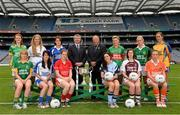 15 July 2013; Pictured at the launch are Pol O Gallchoir, Ceannsaí TG4, and Pat Quill, President of the Ladies Football Association, with players, from left to right, Deirdre Foley, Donegal, Eileen Rahill, Meath, Maria Moolick, Kildare, Therese McNally, Monaghan, Maggie Murphy, Laois, Ann Marie Walsh, Cork, Sinead Goldrick, Dublin, Fiona McHale, Mayo, Trina Durkan, Westmeath, Bernie Breen, Kerry, Mags McAlinden, Armagh, and Emer Gonsidine, Clare. September 29th will be the 40th time that the final of the Senior Ladies Gaelic Football Final will be contested. The first final took place in October 1974 and was contested by Tipperary and Offaly in a game that was won by the Tipperary women. The most successful team in the history of the game are Kerry who have won the title on 11 occasions including an unprecedented 9-in-a-row. In recent years Cork have been the dominant force winning 7 of the last 8 titles. TG4 made the announcement that RefCam will be introduced to Irish Sport for the first time. The lightweight head mounted device will be a feature of TG4's live coverage of the 2013 Ladies Football Championship and will provide viewers with unique insight into the game but it will also be a hugely valuable coaching resource for referees. 2013 TG4 All-Ireland Ladies Football Championship Launch, Croke Park, Dublin. Picture credit: David Maher / SPORTSFILE