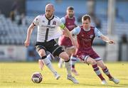 21 June 2021; Chris Shields of Dundalk in action against Mark Doyle of Drogheda United during the SSE Airtricity League Premier Division match between Drogheda United and Dundalk at Head in the Game Park in Drogheda, Louth. Photo by Piaras Ó Mídheach/Sportsfile