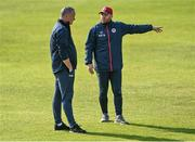 21 June 2021; St Patrick's Athletic manager Alan Mathews, left, and St Patrick's Athletic head coach Stephen O'Donnell speak before the SSE Airtricity League Premier Division match between St Patrick's Athletic and Finn Harps at Richmond Park in Dublin. Photo by Harry Murphy/Sportsfile