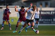 21 June 2021; Greg Sloggett of Dundalk gets past Chris Lyons of Drogheda United during the SSE Airtricity League Premier Division match between Drogheda United and Dundalk at Head in the Game Park in Drogheda, Louth. Photo by Piaras Ó Mídheach/Sportsfile