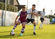 21 June 2021; Chris Lyons of Drogheda Unitedcin action against Raivis Jurkovskis of Dundalk during the SSE Airtricity League Premier Division match between Drogheda United and Dundalk at Head in the Game Park in Drogheda, Louth. Photo by Piaras Ó Mídheach/Sportsfile