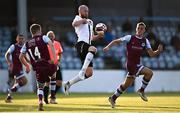21 June 2021; Chris Shields of Dundalk in action against Mark Doyle, left, and Killian Phillips of Drogheda United during the SSE Airtricity League Premier Division match between Drogheda United and Dundalk at Head in the Game Park in Drogheda, Louth. Photo by Piaras Ó Mídheach/Sportsfile