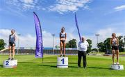 19 June 2021; Athletics Ireland President John Cronin with Junior Women's 5000m medallists, from left, Aoife McGreevy of Lagan Valley AC, Donegal, silver, Laura Mooney of Tullamore Harriers AC, Offaly, gold, and Holly Brennan of Cilles AC, Meath, during day one of the Irish Life Health Junior Championships & U23 Specific Events at Morton Stadium in Santry, Dublin. Photo by Sam Barnes/Sportsfile
