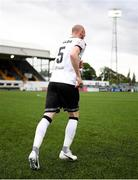 25 June 2021; Dundalk captain Chris Shields leads his side out ahead of playing his final game for the club before the SSE Airtricity League Premier Division match between Dundalk and Derry City at Oriel Park in Dundalk, Louth. Photo by Stephen McCarthy/Sportsfile
