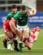 25 June 2021; Tim Corkery of Ireland makes a break during the U20 Six Nations Rugby Championship match between Wales and Ireland at Cardiff Arms Park in Cardiff, Wales. Photo by Gareth Everett/Sportsfile