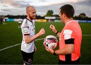 25 June 2021; Chris Shields of Dundalk having played his final game for the club, with referee Rob Harvey, after the SSE Airtricity League Premier Division match between Dundalk and Derry City at Oriel Park in Dundalk, Louth. Photo by Stephen McCarthy/Sportsfile