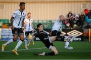 25 June 2021; Chris Shields of Dundalk defends a shot from Patrick Ferry of Derry City during the SSE Airtricity League Premier Division match between Dundalk and Derry City at Oriel Park in Dundalk, Louth. Photo by Stephen McCarthy/Sportsfile